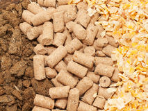 Sunflower meal, maize and bran background. Food for horses Stock Image