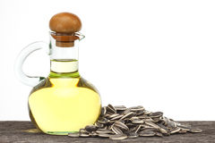 Sunflower oil. In bottle glass with seed on the old plank wood Royalty Free Stock Photo