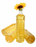 Sunflower oil in bottles. C artificial colors of sunflower on a white background Stock Photography