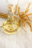 Sunflower oil and ears of wheat Royalty Free Stock Photo