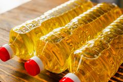 Sunflower oil. Factory line of production and filling of refined oil from sunflower seeds. Factory conveyor of food industry.  Royalty Free Stock Images