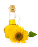 Sunflower oil with flower. Isolated on white Royalty Free Stock Images