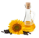 Sunflower oil with flower and seeds. On a white background Royalty Free Stock Photo