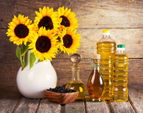 Sunflower oil and flowers Royalty Free Stock Photography
