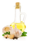 Sunflower oil in a glass bottle with garlic and parsley Royalty Free Stock Images