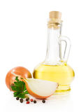 Sunflower oil in a glass bottle with onion and parsley Royalty Free Stock Image