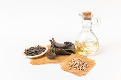 Sunflower oil, oilcake and sunflower seeds. Stock Photos