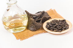Sunflower oil, oilcake and sunflower seeds. Royalty Free Stock Photography