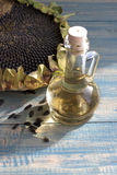 Sunflower oil. Sunflower seeds in the bag, and sunflower oil in a bottle Royalty Free Stock Image
