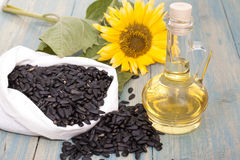Sunflower oil. Sunflower seeds in the bag, and sunflower oil in a bottle Royalty Free Stock Photos