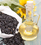 Sunflower oil. Sunflower seeds in the bag, and sunflower oil in a bottle Royalty Free Stock Photo