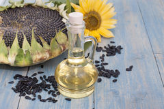 Sunflower oil. Sunflower seeds in the bag, and sunflower oil in a bottle Royalty Free Stock Images