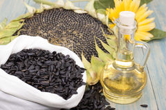 Sunflower oil. Sunflower seeds in the bag, and sunflower oil in a bottle Stock Photography