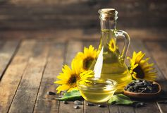 Sunflower oil and seeds. On the wooden table Royalty Free Stock Image