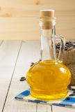 Sunflower oil and seeds on wood Stock Photo