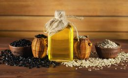Sunflower oil and sunflower seeds on wooden background royalty free stock photo