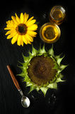 Sunflower oil in a spoon and sunflower Stock Photos