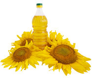 Sunflower oil and sunflower. On white background Stock Photo