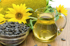 Sunflower oil and sunflower flowers close-up royalty free stock photography