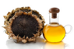Sunflower oil and sunflower ripe Stock Photos
