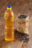 Sunflower oil and sunflower seeds Stock Images
