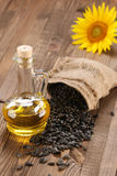 Sunflower oil and sunflower seeds Stock Photography