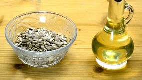 Sunflower oil with sunflower seeds stock video footage