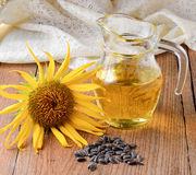 Sunflower oil with sunflower on wooden background. royalty free stock photos