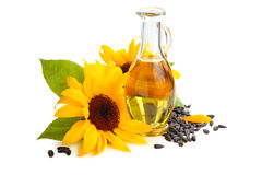 Sunflower oil. Sunflowers, sunflower oil and sunflower seeds. Isolated on white background royalty free stock photo