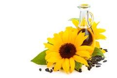 Sunflower oil. Sunflowers, sunflower oil and sunflower seeds. Isolated on white background Stock Photo