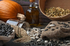 Sunflower and pumpkin seeds on the wooden table Stock Photo