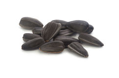 Sunflower's seeds. Handful of black seeds of sunflower on the white background Royalty Free Stock Photography