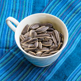 Sunflower seed. In ceramic dish on blue scarf Stock Photography