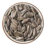 Sunflower seed. Close up sunflower seed in ceramic dish isolated on white - with path Royalty Free Stock Photo