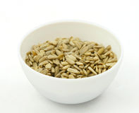Sunflower seed cores in a white bowl Stock Photo