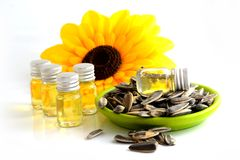 Sunflower seed with drop of oil in the bottle. Royalty Free Stock Image