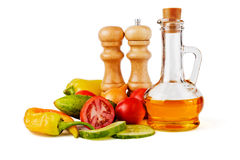Sunflower seed oil and vegetables Stock Photos