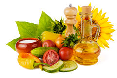 Sunflower seed oil and vegetables Royalty Free Stock Image