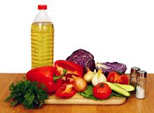 Sunflower seed oil and vegetables for salad Royalty Free Stock Photography