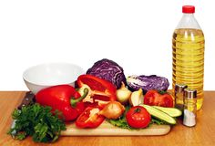 Sunflower seed oil and vegetables for salad Stock Image