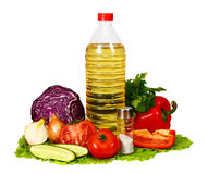 Sunflower seed oil and vegetables for salad Stock Images