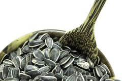 Sunflower seed in wood bowl Stock Photo