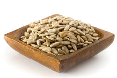 Sunflower seeds. In old wooden bowl against white background Royalty Free Stock Images