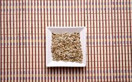 Sunflower seeds. In a white bowl Stock Photo