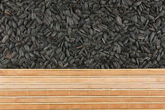 Sunflower seeds and bamboo mat Royalty Free Stock Photos