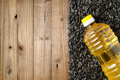 Sunflower seeds and bottle of sunflower oil Royalty Free Stock Photography
