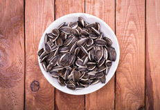 Sunflower seeds bowl above Stock Photos