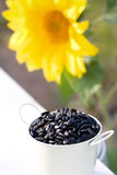 Sunflower seeds in bucket and sunflower Royalty Free Stock Image