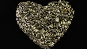 Sunflower seeds in the form of heart royalty free stock photos
