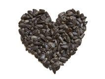 Sunflower seeds - heart shape. Isolated Stock Photo